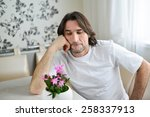 a man with a pink orchid in the ... | Shutterstock . vector #258337913