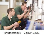senior technician and junior... | Shutterstock . vector #258342233
