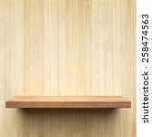 empty shelf on a wooden wall   Shutterstock . vector #258474563