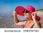 happy mature woman with pink... | Shutterstock . vector #258554783