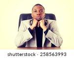 thoughtful african businessman... | Shutterstock . vector #258563993