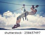 active sportive woman hanging... | Shutterstock . vector #258657497