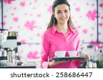 Young Smiling Waitress In Pink...