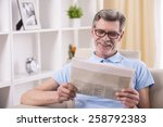 senior man is reading newspaper ... | Shutterstock . vector #258792383