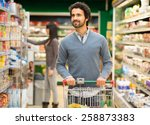 handsome man shopping in a... | Shutterstock . vector #258873383