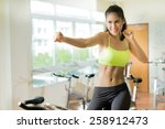 Small photo of Woman exercising in the gym Cycling for Weight Loss For good health ,She acted with punch