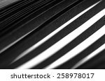 curled in a roll black paper... | Shutterstock . vector #258978017