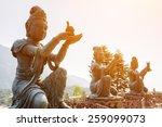 buddhist statues praising and...