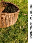 vintage picnic basket on grass | Shutterstock . vector #259108703
