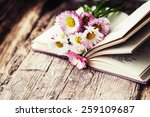 Vintage Books With Bouquet Of...