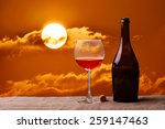 bottle and glass of red wine on ... | Shutterstock . vector #259147463