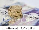 Stack Of Pound Coins On Twenty...