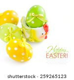 colorful easter eggs on white... | Shutterstock . vector #259265123