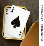 Small photo of Ace of spades in box on wooden table background