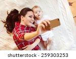 cute little baby girl and her... | Shutterstock . vector #259303253