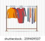 clothes racks with dresses on... | Shutterstock .eps vector #259409537