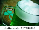 a glass mug with dyed green... | Shutterstock . vector #259432043