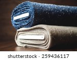 rolls of blue and brown fabric...