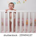 cute baby in crib | Shutterstock . vector #259494137