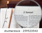 "Small photo of CHIANGMAI, THAILAND, March 3,2015. Reading The New International Version of the Holy Bible on the page of "" 2 samuel "" at home. March 3,2015"