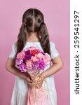 Cute Girl Hiding Flowers