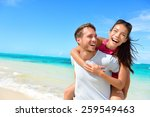 happy couple in love on beach... | Shutterstock . vector #259549463