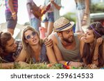 happy hipsters chatting on the... | Shutterstock . vector #259614533