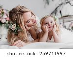 beautiful young mother and here ... | Shutterstock . vector #259711997