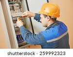 young adult electrician builder ... | Shutterstock . vector #259992323