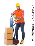 happy man in yellow hardhat and ... | Shutterstock . vector #260034677