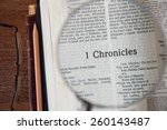 "Small photo of CHIANGMAI, THAILAND, March 3,2015. Reading The New International Version of the Holy Bible on the page of "" 1 chronicles "" at home. March 3,2015"