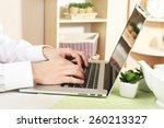 man working on laptop on wooden ...   Shutterstock . vector #260213327