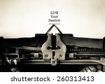 Small photo of Live your Passion inspirational message typed on vintage typewriter
