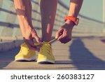 urban jogger tying his running... | Shutterstock . vector #260383127