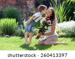 Beautiful Kid And Mom In Sprin...