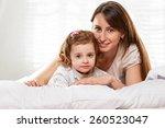 portrait of a joyful mother and ... | Shutterstock . vector #260523047