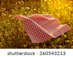 Small photo of Hankie aflutter on grass field