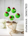 Small photo of Cake pops decorated with fondant ladybugs