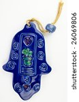 Hamsa hand amulet, used to ward off the evil eye - ceramic wall decoration - stock photo
