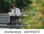 man with laptop and coffee at... | Shutterstock . vector #260701673