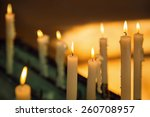 several church candles against... | Shutterstock . vector #260708957