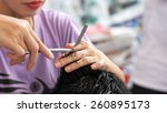 hairdresser cuts hair with... | Shutterstock . vector #260895173