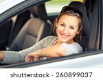 pretty young woman driving her... | Shutterstock . vector #260899037