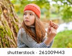 little beautiful girl in red...   Shutterstock . vector #261009443