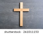 wooden cross on rusty black... | Shutterstock . vector #261011153