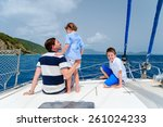 Father And Kids Sailing On A...
