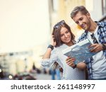 Young Couple With A Map In The...