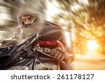 Постер, плакат: biker riding fast with