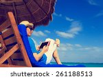 man with touch pad on tropical... | Shutterstock . vector #261188513