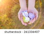 girl holding easter eggs in her ...   Shutterstock . vector #261336407